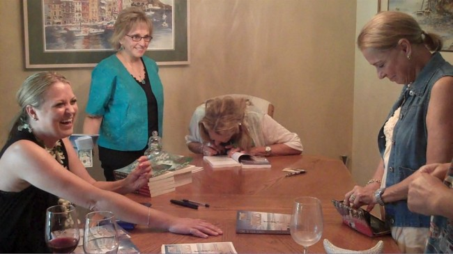 "Joan Autographed Advanced Copies of ""Come to Your Senses"""